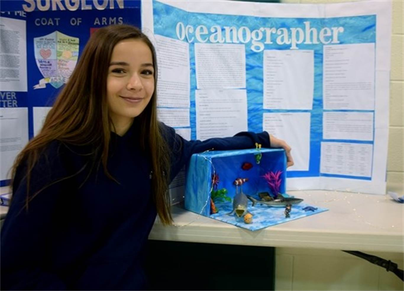 Grade 8 student Maria Andrejciw displays her career portfolio on oceanography during St. Luke Catholic Elementary School's fourth career day on May 3. Photo by Laura Lennie, Stoney Creek News.