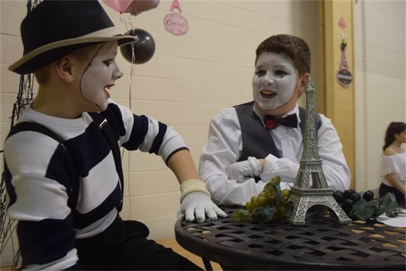 Grade 7 students Mitchell Harrington and Nicholas Gates, left to right, chat in a bistro-like setting at St. Luke Catholic Elementary School's A day in Paris event on May 8. Photo by Laura Lennie, Stoney Creek News